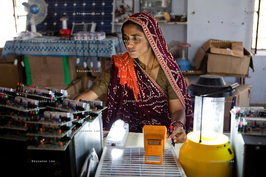 Kamla Devi, aged 38, from Shironj, Ajmer, Rajasthan, was Rajasthan's first woman Barefoot Solar Engineer. She had become a Barefoot Solar Engineer 17 years ago and has been practicing since. Now, besides being a solar engineer, she empowers other women and teaches at the Barefoot College in Tilonia village, Ajmer, Rajasthan, India. Photo by Suzanne Lee for Panos London
