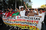 Mexican electric workers raise their fists during a rally to protest against the privatization of the electric energy in Mexico, October 08, 2009. Thousands of workers marched to the presidential residence of Los Pinos.  Photo by Heriberto Rodriguez