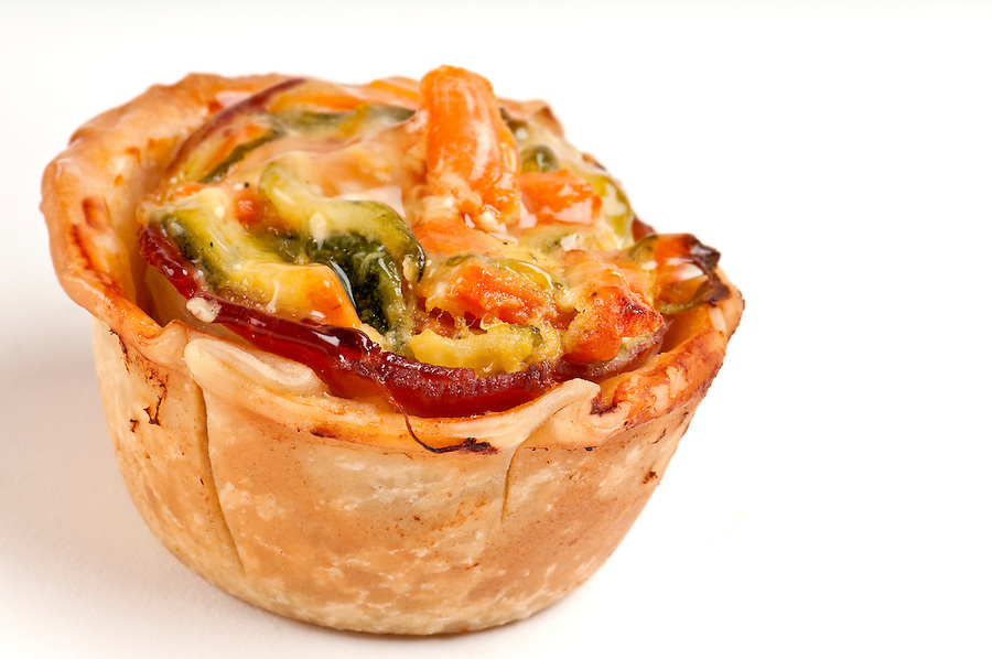 Homemade mini quiche of vegetables close up