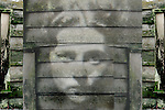 A womans face montaged on a wooden panel