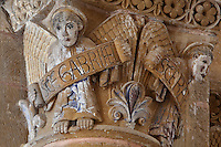 Carved capital with archangels Gabriel and Raphael, from the junction of the nave and the transept, in the Abbatiale Sainte-Foy de Conques or Abbey-church of Saint-Foy, Conques, Aveyron, Midi-Pyrenees, France, a Romanesque abbey church begun 1050 under abbot Odolric to house the remains of St Foy, a 4th century female martyr. The church is on the pilgrimage route to Santiago da Compostela, and is listed as a historic monument and a UNESCO World Heritage Site. Picture by Manuel Cohen