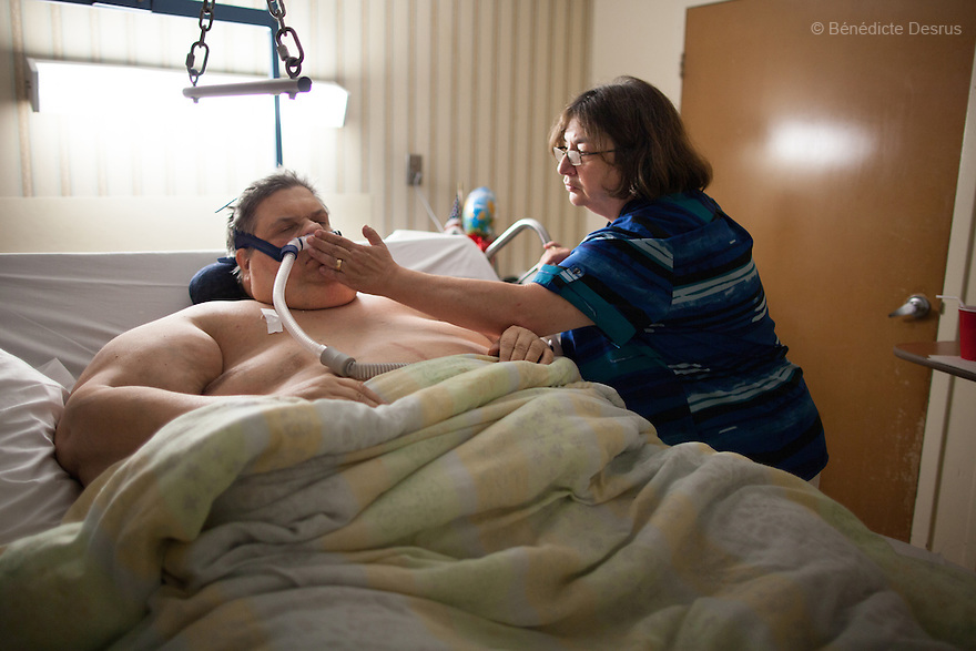 Michael Hebranko, and his wife Madelaine Hebranko, at the Brookhaven Rehabilitation and Health Care Center, a home that treats morbidly obese patients, in Far Rockaway, New York on August 1, 2012. <br /> Michael Hebranko is an American man suffering from an extreme case of morbid obesity, known to be among the heaviest people in the world. Michael was born in Brooklyn in 1954. At the age of 16 his weight was 353 pounds. In 1990, he was recorded in the Guinness Book of World Records for the highest recorded weight loss. He dropped his weight from 906&nbsp;pounds to 200&nbsp;pounds in 19 months with the help of the dieting and exercise coach Richard Simmons. But then he gained most of the weight back again and in June 1999, Hebranko was at his peak weight of 1,100 pounds. Over the past years, he had to be repeatedly hospitalized and today he weighs 550 pounds and is battling for his life. He says: &ldquo;I'm a food addict, and like any alcoholic who has their first drink, or heroin addict who first injects, I fell off the wagon.&rdquo; <br /> Michael Hebranko died on July 25, 2013. He was an advocate for the obese and founded OPIN, a non-profit organization dedicated to teaching and helping people that suffered from obesity and also educating the public on this condition. His whole life he battled with obesity. Photo by B&eacute;n&eacute;dicte Desrus