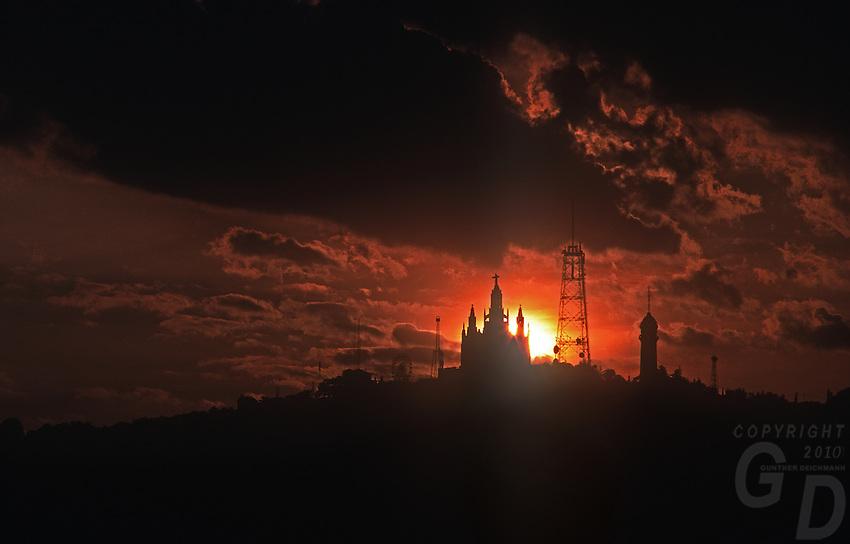 Dramatic sunset over the the Temple Expiatori del Sagrat Cor, Expiatory Church of the Sacred Heart of Jesus, Templo Expiatorio del Sagrado Corazón de Jesús) is a Roman Catholic church and minor basilica located on the summit of Mount Tibidabo in Barcelona, Catalonia, Spain.