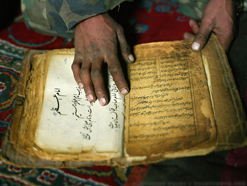 "Boorkhan-u Din teaches the Koran in Uzbek (Turkish language, coming close to Kyrgyz). Only form of ""school"" in the Little Pamir..Campment of Sary Tash..Winter expedition through the Wakhan Corridor and into the Afghan Pamir mountains, to document the life of the Afghan Kyrgyz tribe. January/February 2008. Afghanistan"