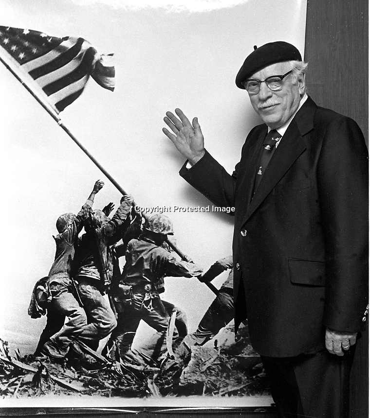 Pulitzer Prize winner Joe Rosenthal standing in front of his photo of the U.S.Marines planting the flag at Iwo Jima. (1981 photo by Ron Riesterer)