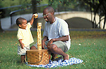 young boy playing with toy blocks with father