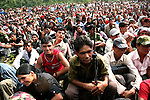 Members of the People?s Liberation Army, the Maoist rebels that have been fighting for control of the country, attend a Maoist gathering in a remote part of western Nepal on June 22, 2006. The ten-year old conflict in Nepal has claimed an estimated 13,000 lives. (Photo/Scott Dalton)