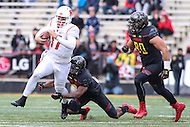 College Park, MD - November 26, 2016: Rutgers Scarlet Knights quarterback Giovanni Rescigno (17) avoids the tackle by Maryland Terrapins defenders during game between Rutgers and Maryland at  Capital One Field at Maryland Stadium in College Park, MD.  (Photo by Elliott Brown/Media Images International)