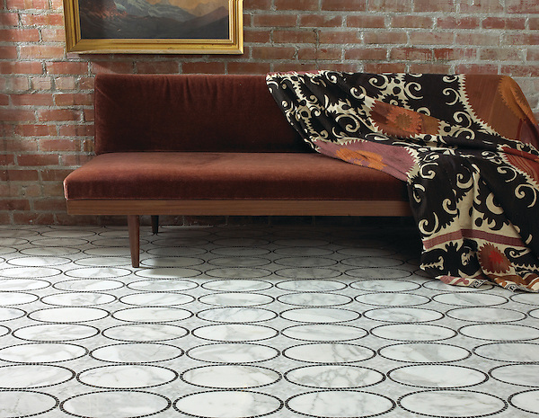Solid Ovals, a natural stone hand cut and waterjet mosaic shown in Calacatta Tia and Nero Marquina, is part of the Silk Road Collection by Sara Baldwin for New Ravenna Mosaics. Take the next step: prices, samples and design help, http://www.newravenna.com/showrooms/