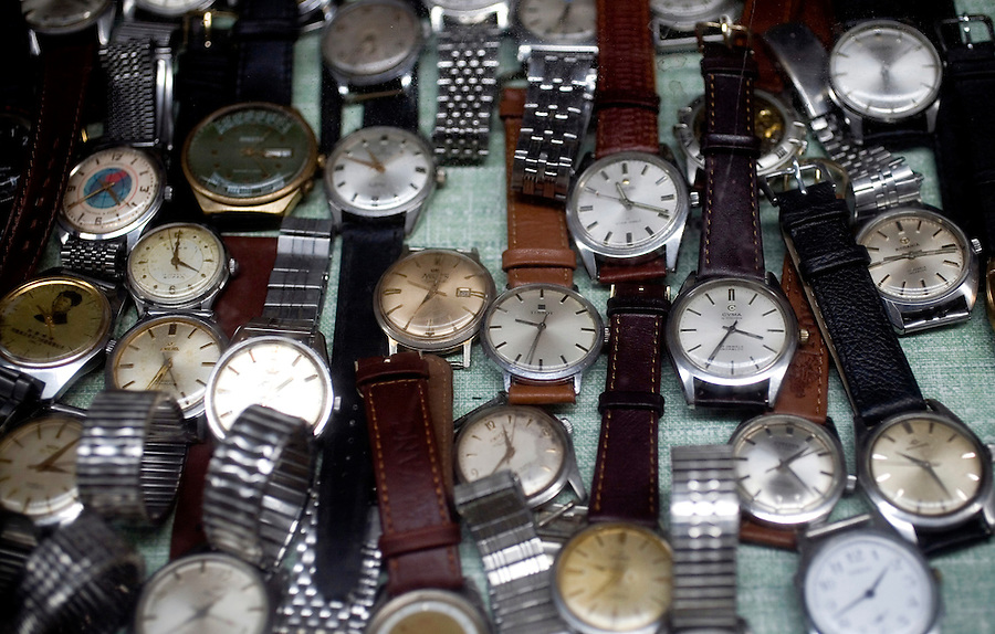 """Antique watches for sale in """"Panjiayuan,"""" Beijing's weekend flea market."""