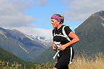 NELSON LAKES, NEW ZEALAND - APRIL 18: Carmel Ali crosses the Travers River during the 2015 Alpine Lodge Loop The Lake trail run at Lake Rotoiti on April 18 16, 2015 in Nelson, New Zealand. (Photo by Marc Palmano/Shuttersport Limited)