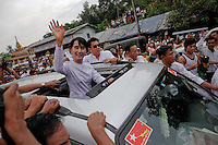 Myanmar's pro-democracy leader Aung San Suu Kyi  waves to supporters as she leaves office of her National League for Democracy (NLD) in Yangon April 2, 2012. Aung San Suu Kyi won a seat in parliament on Sunday, her party said, after an historic by-election that is testing the country's nascent reform credentials and could persuade the West to end sanctions. REUTERS/Damir Sagolj (MYANMAR)