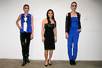 Fashion designer Ivy Higa, poses with models at her Fall/Winter 2011 collection presentation, during New York Fashion Week Fall 2011.
