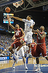 UK's Anthony Davis defends Arkansas Rashad Madden during the first half of the University of Kentucky men's basketball game against Arkansas at Rupp Arena in Lexington, Ky., on 1/17/12. Photo by Mike Weaver | Staff