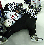 20 Oct 2006 Omaha NE Linesmen Todd Lacina and Nathan Stanton try to pull University of Nebraska at Omaha's Juha Uotila off  Niagara University's Nate Bostic during second period of the Maverick Stampede hockey tournament at the Qwest Center Omaha Friday night.  Bostic had checked a player into the Mav bench.  (photo by Chris Machian/Prairie Pixel Group)UNO won in the first game of the Maverick Stampede.