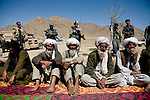 Local Afghan leaders, mostly poppy farmers attend a shura, or community meeting in Chenar, Kandahar province, Afghanistan that involved local Afghans, US military, Afghan governing officials, and NATO leaders in an area that is heavily influenced by the Taliban on Thursday, March 22, 2007.