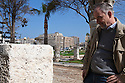 Der Spiegel correspondent Dr. Rainer Traub examines an ancient slab inscribed with the name of Eqyptian Queen Cleopatra on display February 02, 2012 in the Kom el Dekka archeological park in Alexandria, Egypt. There are few remaining artifacts from Ceopatra's reign, and many items remain submerged in the harbor of Alexandria where her Palace complex once stood. (Photo by Scott Nelson)