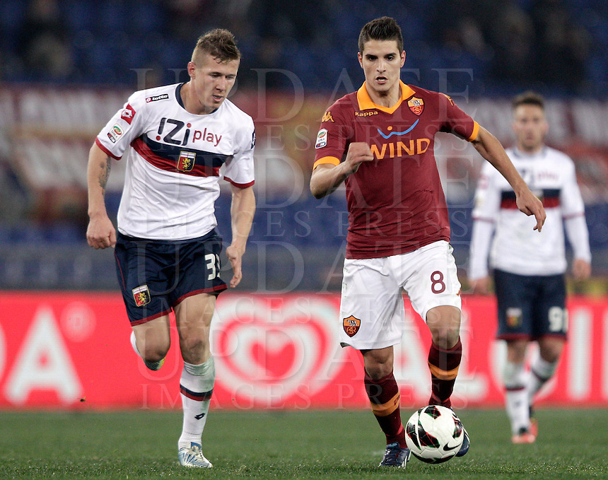 Calcio, Serie A: Roma vs Genoa. Roma, stadio Olimpico, 3 marzo 2013..AS Roma forward Erik Lamela, of Argentina, right, is chased by Genoa midfielder Jurai Kucka, of Slovakia, during the Italian Serie A football match between AS Roma and Genoa at Rome's Olympic stadium, 3 March 2013..UPDATE IMAGES PRESS/Riccardo De Luca