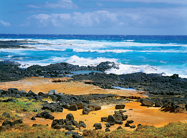 breaking waves on rocky and sandy beach, South Point, Hawaii
