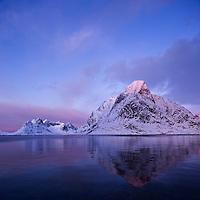 Reflection of winter mountain peaks in Kjerkefjord, Reine, Moskenesøy, Lofoten islands, Norway