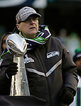 Seahawks owner and Chairman of Vulcan Sports and Entertainment,  Paul Allen holds the Vince Lombardi Trophy during the Super Bowl XLVIII celebration at  CenturyLink Field on February 5, 2014 in Seattle. Allen, who bought a struggling Seattle Seahawks franchise in 1997, now, after 17 years, his team beat the Denver Broncos  43-8 to become Super Bowl Champions. ©2014. Jim Bryant Photo. ALL RIGHTS RESERVED.