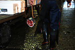 """An employee at the world's largest fish market in Tsukiji, Tokyo carries away ta portion of a large tuna after auctioning at the market. More than 2,300 tons of fish -- about one-third of the total consumed in Japan -- passes through Tsukiji each day and the market offers more than 450 varieties of marine products. The market, which dates back almost 75 years, is slated to move to a high-tech site on a man-made island in Toyosu, which is well-documented as being contaminated with benizine. Not that Tsukiji is much better off -- many buildings in the aging site are stuffed with asbestos. """"Choose your poison,"""" says one Tsukiji official. The new site, which the government plans to be readied by 2012, will be significantly larger, with more room for off-loading and for sellers to display their goods. The current location, says one official, is too cramped and collisions between motorised carts and pedestrians means accidents occur almost daily. Meanwhile, with fish sales down, it is becoming more difficult to justify Tsukiji's prime location and property developers are keeping a close watch on Tsukiji land, which is just a few blocks from the ritzy Ginza district of Tokyo, where per-meter land prices are among the highest in the world...The move to the new Toyosu location, meanwhile, has been at the center of heated debate -- clean-up operations alone are estimated to cost ¬?67 billion (around US$660 million), with a further ¬?450 billion to build a new marketplace. Big wholesalers favour the move, but the 1,600-plus merchants mostly are against it. Yoshiharu Kikuraku, a Tsukiji storeowner who began working at the market 60 years ago, expresses bewilderment at the plans, saying that the name Tsukiji itself has become synonymous with the world's best and most eclectic selection of fish. """"This place has a long tradition. Why break it and start from scratch all over again?"""" he says."""