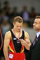Oct 19, 2006; Aarhus, Denmark;  Fabian Hambuechen of Germany celebrates bronze medal win during men's All-Around medals ceremony at 2006 World Championships Artistic Gymnastics.<br />