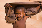 A young boy walks the streets of his West African hometown of Torodi, Niger.