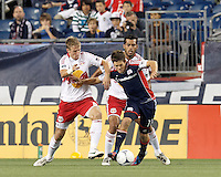New York Red Bulls defender Jan Gunnar Solli (8) and New England Revolution midfielder Kelyn Rowe (11) battle for the ball. New York Red Bulls defender Wilman Conde (2). Despite a red-card man advantage, in a Major League Soccer (MLS) match, the New England Revolution tied New York Red Bulls, 1-1, at Gillette Stadium on September 22, 2012.