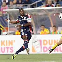 New England Revolution forward Dimitry Imbongo (92) takes a shot. In a Major League Soccer (MLS) match, the New England Revolution defeated Columbus Crew, 2-0, at Gillette Stadium on September 5, 2012.