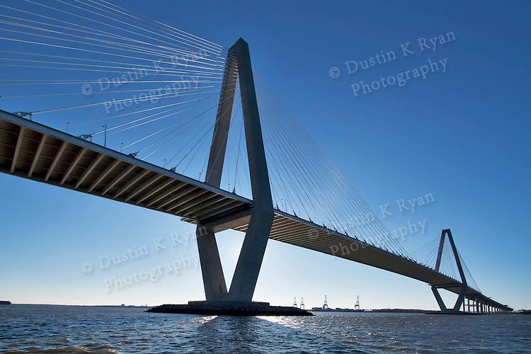 Arthur Ravenel Jr Bridge Charleston South Carolina also known as the Cooper River Bridge.  Blue skies and container ships