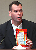 Investigator for the Hanover County (Virginia) Sheriff's Office, Drew Darby, holds a bag of evidence from the shooting scene at the Ponderosa Steak House in Ashland, Virginia during his testimony in the trial of sniper suspect John Allen Muhammad in courtroom 10 at the Virginia Beach Circuit Court in Virginia Beach, Virginia, on October 31, 2003. <br /> Credit: Adrin Snider - Pool via CNP