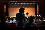 "Movie-goers find their seats before the premiere of ""Son of Babylon"" by Iraqi filmmaker Mohamed Al-Daradji, at the Semiramis Theater in Baghdad, Iraq, May 6, 2010. The movie about a boy and his grandmother's search for his missing father was filmed in Iraq and was recognized worldwide, including the Sundance Film Festival."