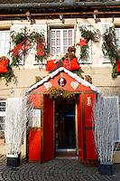 festive restaurant window with Christmas decorations. Petit France, Strasbourg Alsace.