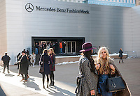 Fashionistas in their finery outside of the Fall 2014 Fashion Week shows in Lincoln Center in New York, seen on opening day, Thursday, February 6, 2014. This year some designers are abandoning the tents at Lincoln Center to hold their shows at far flung venues, including Brooklyn.  (© Richard B. Levine)