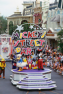 Orlando, Florida - Circa 1986. Crowds watch Disney World performers at Mickey's Street Party (held between January 1985 - 1986). Characters Mickey Mouse and Donald Duck stand on board a float while the Br'er Fox and Br'er Bear walk behind. Disney World is a world-renowned entertainment complex that opened October 1, 1971 in Lake Buena Vista, FL. Now known as the Walt Disney World Resort, the property covers 25,000 acres and has an annual attendance of 52.5million people.