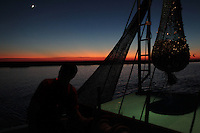 Jason Melerine shrimping with Katie Landry and Stephen Tircuit on Delacroix Island, LA on November 8, 2010.