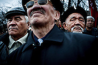 Men take part in a demonstration against President Kurmanbek Bakiyev in Bishkek.
