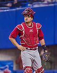 4 April 2015: Cincinnati Reds catcher Devin Mesoraco in action against the Toronto Blue Jays at Olympic Stadium in Montreal, Quebec, Canada. The Blue Jays defeated the Reds 9-1 in the second of two MLB weekend exhibition games. The series marked the first time since 2004 that the Reds played at Olympic Stadium, during the last season of the Montreal Expos. Mandatory Credit: Ed Wolfstein Photo *** RAW (NEF) Image File Available ***