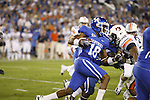 Running back Randall Cobb runs into a pack of Auburn defenders during the first half of UK's home game against Auburn, Oct. 9, 2010. Photo by Brandon Goodwin| Staff