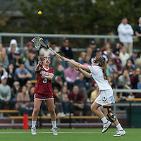 Newton, Massachusetts - February 25, 2017: NCAA Division I. In overtime, Boston College (white) defeated Harvard University (crimson), 13-12, at Newton Campus Lacrosse Field.