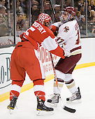 David Warsofsky (BU - 5), Brian Gibbons (BC - 17) - The Boston College Eagles defeated the Boston University Terriers 3-2 (OT) in their Beanpot opener on Monday, February 7, 2011, at TD Garden in Boston, Massachusetts.