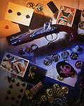 Pistol with coins and playing cards