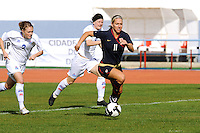 Lauren Cheney attacks the goal, as Sif Atladottir and Katrin Jonsdottir of Iceland attempt to chase.  The USWNT defeated Iceland (2-0) at Vila Real Sto. Antonio in their opener of the 2010 Algarve Cup on February 24, 2010.