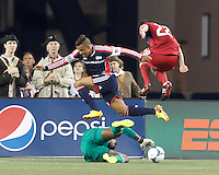 New England Revolution substitute forward Charlie Davies (99) returns. Charlie Davies attack thwarted by Chicago Fire goalie. In a Major League Soccer (MLS) match, the New England Revolution (blue) defeated Chicago Fire (red), 2-0, at Gillette Stadium on August 17, 2013.