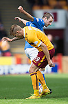 Motherwell v St Johnstone...30.08.14  SPFL<br /> Dave Mackay tackles Lee Erwin<br /> Picture by Graeme Hart.<br /> Copyright Perthshire Picture Agency<br /> Tel: 01738 623350  Mobile: 07990 594431