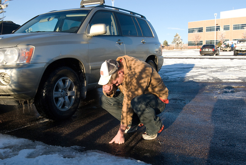 A concerned onlooker who wished to remain unidentified prays outside the New Life megachurch in Colorado Springs, Colo., Sunday, Dec. 9, 2007. A gunman allegedl.y shot four church goers -- possibly youth group members -- in the second of two shootings at Coplorado religious organizations in a single day. (Kevin Moloney for the New York Times)