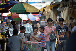 People in the market in the Zeitoun neighborhood of Gaza City, Gaza. Residents of the Palestinian territory are still reeling from the death and destruction of the 2014 war with Israel, and the continuing siege of the seaside territory by the Israeli military.