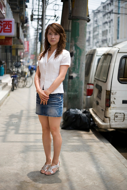 Wangcaiqin, a teacher, age 28, poses for a portrait in Nanjing. Response to 'What does China mean to you?': 'A country with relatively strong racial unity.  A large family.'  Response to 'What is your role in China's future?': 'I don't know yet, I hope the country will get stronger and stronger and that the people's lives will get more and more peaceful.'