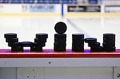 Pucks arranged on the Lowell boards prior to warmups. - The University of New Hampshire Wildcats visited the University of Massachusetts-Lowell River Hawks at Tsongas Arena in Lowell, Massachusetts, on Thursday, December 2, 2010.